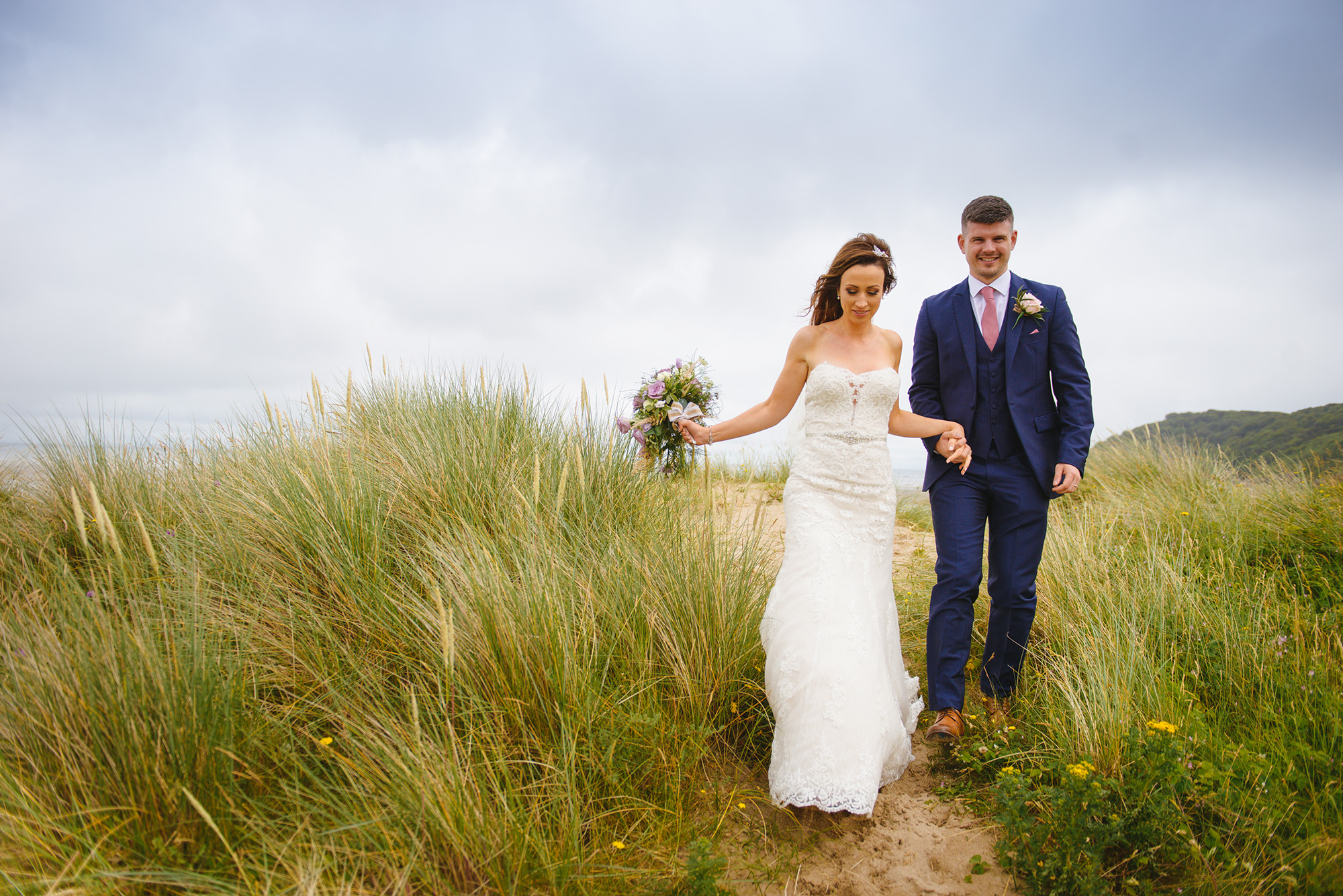 Bride and groom at Oxwich Bay, Gower